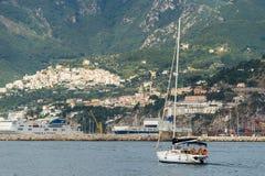 Single yacht near shore, rear three-quarters view stock photos