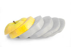 Single yellow apple cut into diagonal slices Royalty Free Stock Images