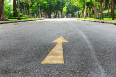 Single yellow arrow sign marking on road surface Royalty Free Stock Photography