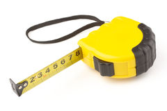 Single yellow and black tape measure Stock Photo