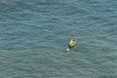 Single yellow boat in the sea Stock Photos