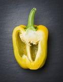 Single yellow cut paprika on stone. Stock Image