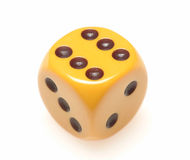 Single yellow die Stock Photo