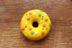 Single yellow donut stock image