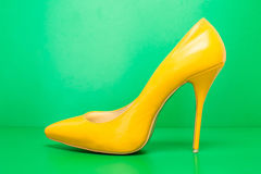 Single yellow high heels Stock Image