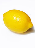 Single Yellow Lemon. Yellow Lemon on a light background Stock Photo
