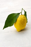 Single yellow lemon with a leaf Royalty Free Stock Photography