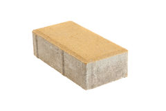 Single yellow pavement brick, isolated. Concrete block for paving Royalty Free Stock Photography