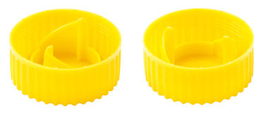 Isolated Ytellow Plastic Bottle Cap Both Sides. Single yellow plastic bottle cap isolated on white background. Top side Stock Images