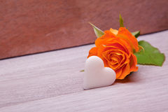 Single yellow rose with white sugar heart Royalty Free Stock Photography