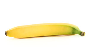Single yellow spotless banana over white. Single yellow spotless banana with an accurate stem isolated over white background Royalty Free Stock Photo