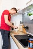 Man preparing dinner stock image