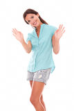 Single young lady gesturing a greeting Stock Photography