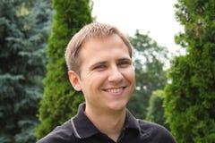 Single young man smiling Stock Photos