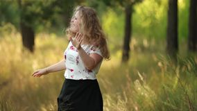 Single Young Pretty Plus Size Caucasian Happy Smiling Laughing Girl Woman In White T-shirt, Dancing In Summer Green. Forest. Fun Enjoy Outdoor Summer Nature stock footage