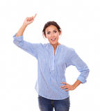 Single young woman pointing up her right arm Royalty Free Stock Photo