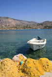 Singola barca e reti da pesca Fotografia Stock