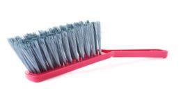 Singola spazzola di plastica isolata sopra fondo bianco Fotografia Stock