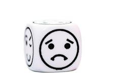 Singoli dadi dell'emoticon con lo schizzo triste di espressione Immagini Stock