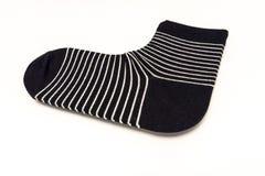 Singolo calzino nero con il modello bianco della banda Fotografia Stock