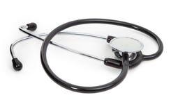 Singolo stetoscopio su bianco Fotografia Stock Libera da Diritti