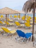 Singular blue deck chair among many yellow Royalty Free Stock Photos