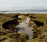 Singular rocky formation at low tide Stock Photo