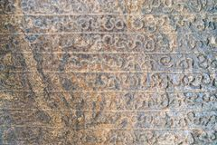 Sinhala inscription on the flat stone surface. Medieval sinhala inscription on the flat stone surface set up by the king Nissanka Malla in the Dambulla Golden Royalty Free Stock Photo