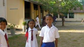 Sinhalese schoolchildren on schoolyard lit by sun. Colombo/Sri Lanka - April 05 2019: Sinhalese schoolchildren on schoolyard lit by bright autumn sun against stock video