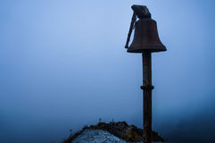 Sinister bell. A sinister bell in a foggy day Royalty Free Stock Photos