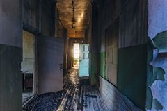Sinister and creepy Corridor of abandoned hospital after fire. Ceiling in black soot.  stock photos