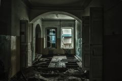 Sinister and creepy interior of abandoned and rotten hospital.  stock photo