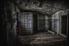 Sinister and creepy interior of abandoned and rotten mental hospital Stock Photos