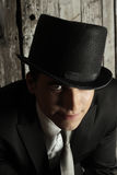 Sinister man. Portrait of a  young man in top hat Royalty Free Stock Photography