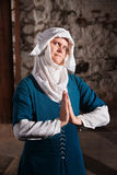 Sinister Nun in Prayer Royalty Free Stock Photography