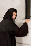 Sinister monk Stock Image