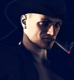 Sinister Sheriff. A sinister sheriff smoking a cigarette. He could be your bane or your saviour in any western inspired story royalty free stock photo