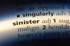 Sinister. Word in a dictionary.  concept stock images