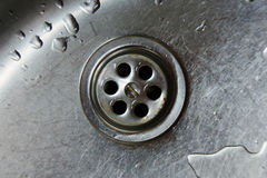 Sink. Metallic Kitchen sink with water drops Royalty Free Stock Images