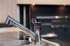 Sink appliance , faucet. Close up royalty free stock images