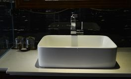 Sink basin faucet in the bathroom stock image