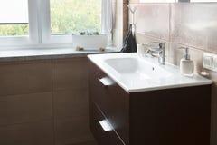 Sink in bathroom near window Royalty Free Stock Photography