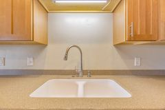 Sink in clean kitchen royalty free stock photography