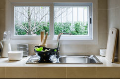 Sink and counter in kitchen Royalty Free Stock Images