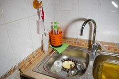 Sink with dirty dishes royalty free stock images