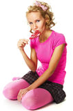 Sink into dotage. Girl with lollipop sitting on floor stock photos