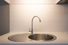 Sink and faucet. Clean sink and faucet on counter Stock Photos