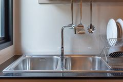 Sink with faucet in kitchen. Room, modern counter with sink in kitchen room, interior design concept stock photography