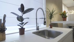 Sink with faucet in kitchen room, modern counter with sink in kitchen room, interior design concept stock video