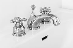 Sink faucet. Two handle sink faucet in a private residence Royalty Free Stock Images